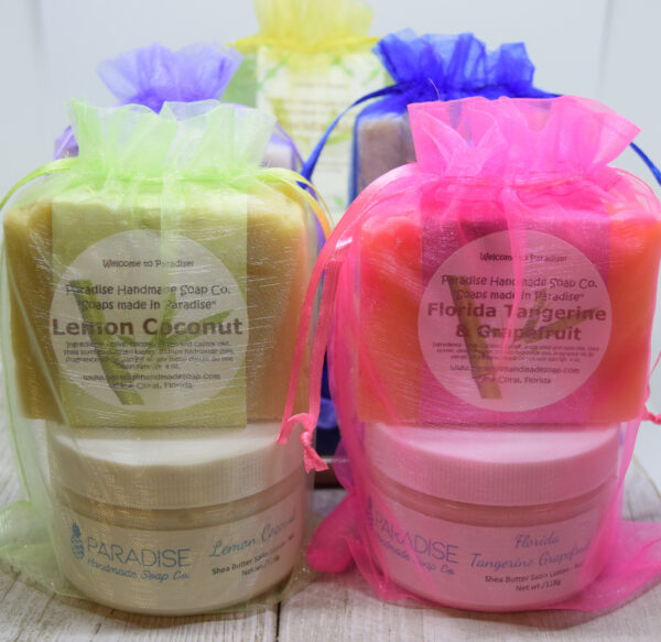 Handmade Soap and Lotion Gift sets on a table in colorful mesh bags, by Paradise Handmade Soap.